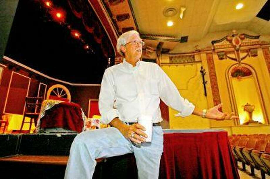 """Jim Bingham shows off the Crighton Theatre on Main Street in Conroe Wednesday. Many people have fond memories of their visits to the """"Crown Jewel."""""""