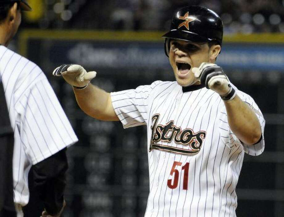 Houston Astros starting pitcher Wandy Rodriguez celebrates his RBI-single, his first hit of the season, in the sixth inning against the Milwaukee Brewers at Minute Maid Park Wednesday night. Rodriguez also got the win, improving to 5-2 on the season. / AP