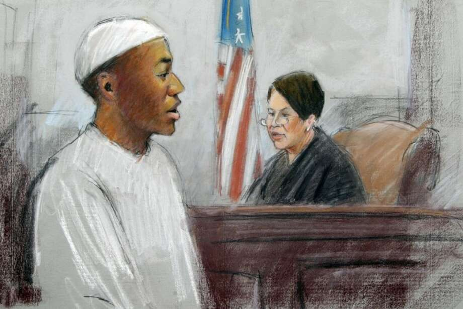 In a courtroom sketch, Umar Farouk Abdulmutallab, the man who tried blowing up a Northwest Airlines flight on Christmas Day 2009, is sentenced to life in prison by U.S. District Judge Nancy Edmonds in federal court in Detroit, Thursday. Photo: Jerry Lemenu