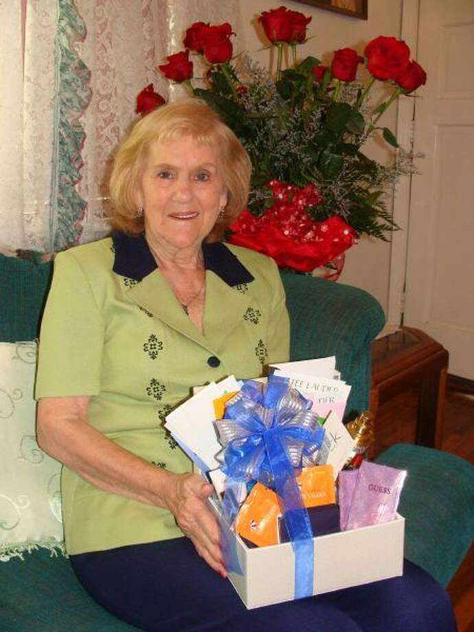 As the winner of the 2009 Mother's Day letter contest, Amanda Luhm received the following donated prizes: roses from Gilmore's Florist in Conroe, dinner from Outback Steakhouse, a massage from Secret Spa and a gift basket from Palais Royal.