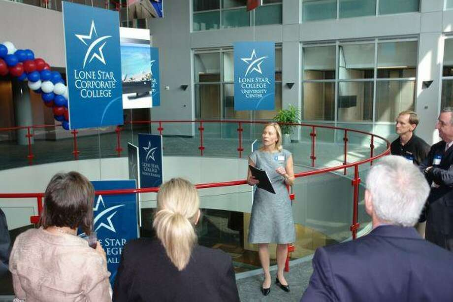 Lone Star College System Project Manager Susan Gallup gives a tour Thursday of the newly purchased Hewlett Packard North Campus the district will use as a future University Center, a new satellite campus, a Corporate College conference and training facility and system administration and support space.