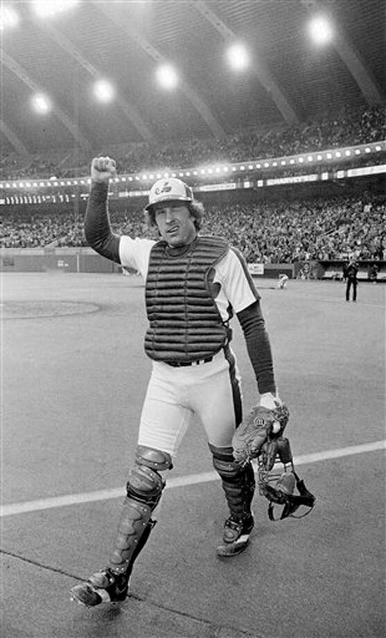 FILE - In t his Oct. 9, 1981, file photo, Montreal Expos catcher Gary Carter winks at the cheering crowd and gives them the clenched fist salute as he leaves the field after the Expos defeated the Philadelphia Phillies 3-1 to take a 2-0 lead in the National League East Division playoffs Montreal. Carter's third inning two-run homer proved to be the game winner. Baseball Hall of Fame president Jeff Idelson said Thursday, Feb. 16, 2012, that Hall of Fame catcher Gary Carter has died. He was 57. (AP Photo/Bill Grimshaw, File) Photo: AP Photo By Bill Grimshaw / AP1981