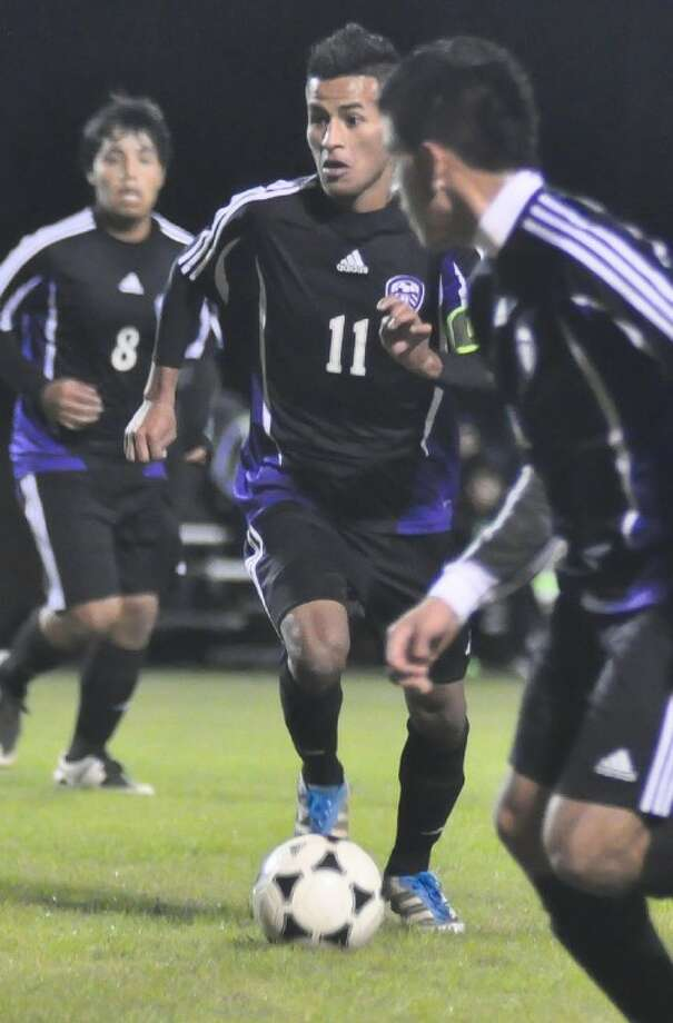 Willis senior central midfielder Juan Miguel Perez leads an attack during a match against Bryan Rudder earlier this season. Perez is the only two-year captain in the history of the Wildkats' program. Photo: Keith MacPherson
