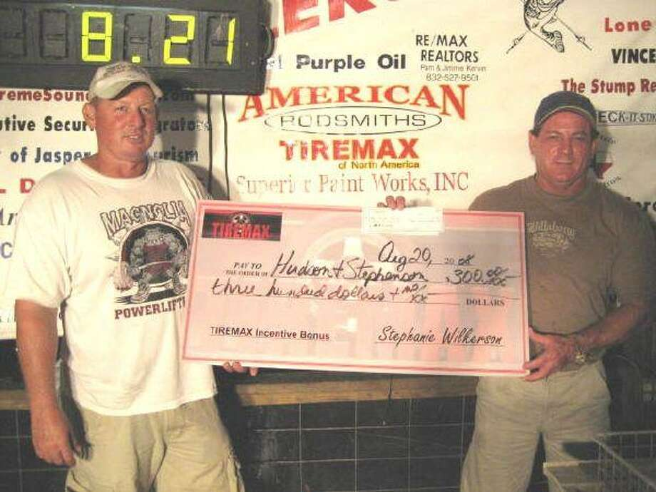 Mike Hudson and John Stephenson show off their winnings from the Anglers Quest Wednesday night tournament at El Dorado Jacks. The duo caught four fish weighing 11.89 pounds. Twenty teams participated in the event. See fishing tournament and shooting league results, page 2B.