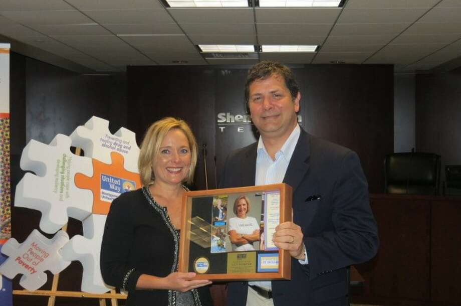 Jim Fredricks, right, board chair for the Montgomery County United Way, presents volunteer Lucy Shanahan with the Volunteer of the Year Award for 2011.