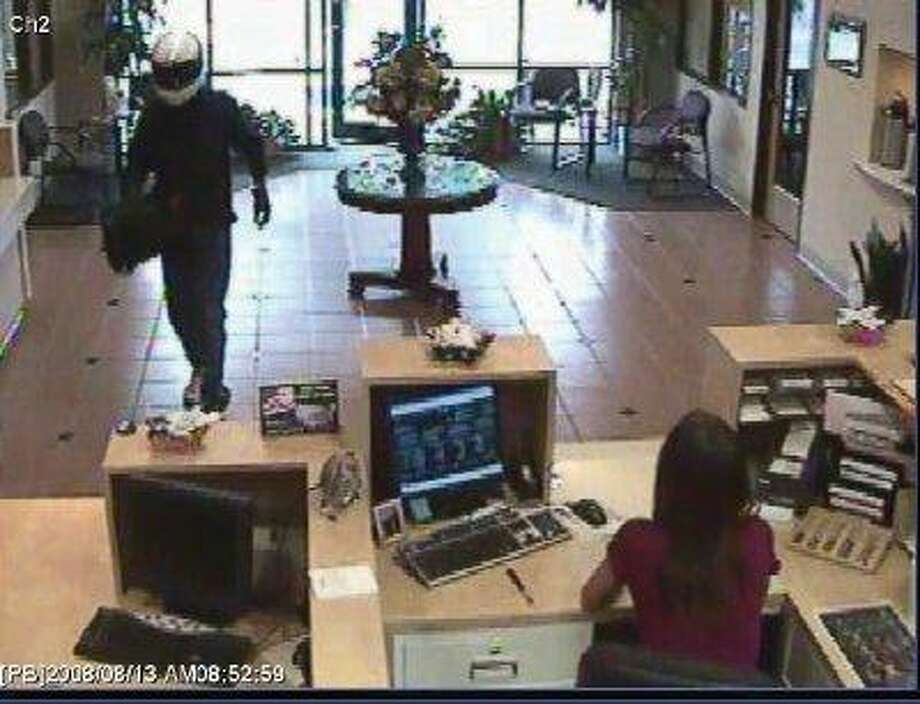Investigators with the Conroe Police Department released this surveillance photo of a robbery suspect entering the First Bank of Conroe Monday morning.