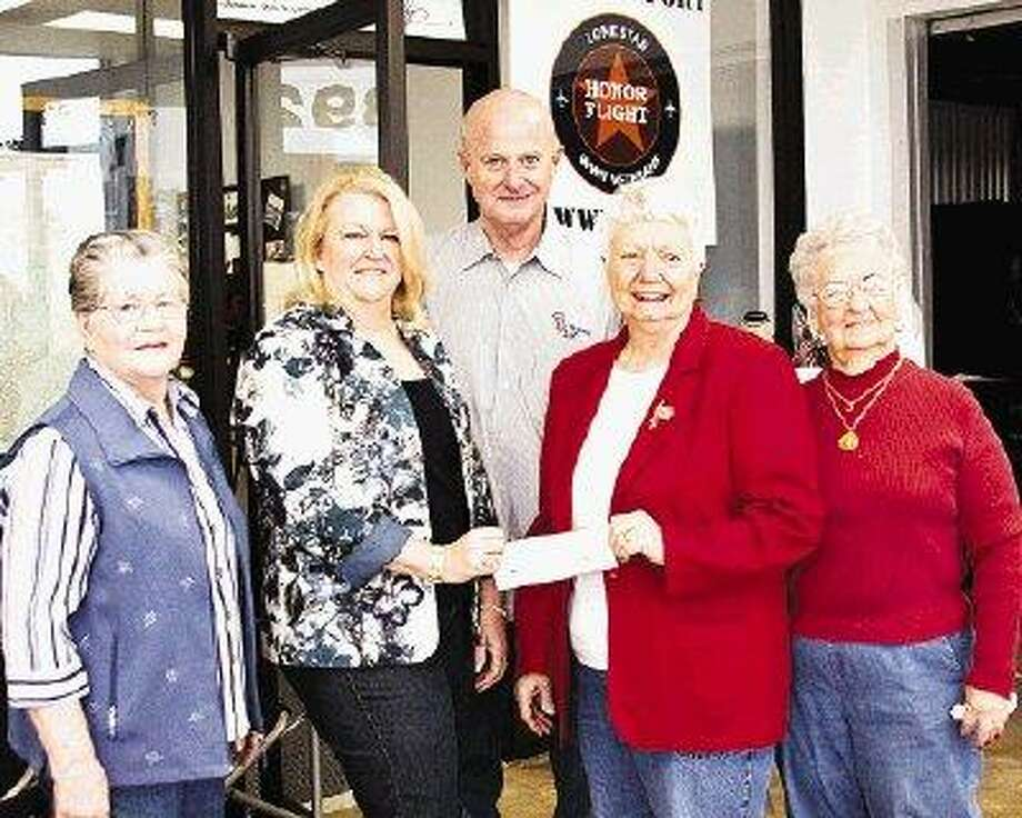 Representatives from VFW Post 4709 in Conroe present Lone Star Honor Flight founder Brenda Beaven with a donation of $5,000 in support of the upcoming trip to transport area World War II veterans to Washington, D.C. Pictured (from left) are Kitty Stephens, VFW Women's Auxiliary; Brenda Beaven; Jack MacClanahan, LSHF co-director; Carol Audferhar, president of VFW Post 4709 Women's Auxiliary and Dolores Mathias, VFW Women's Axiliary.