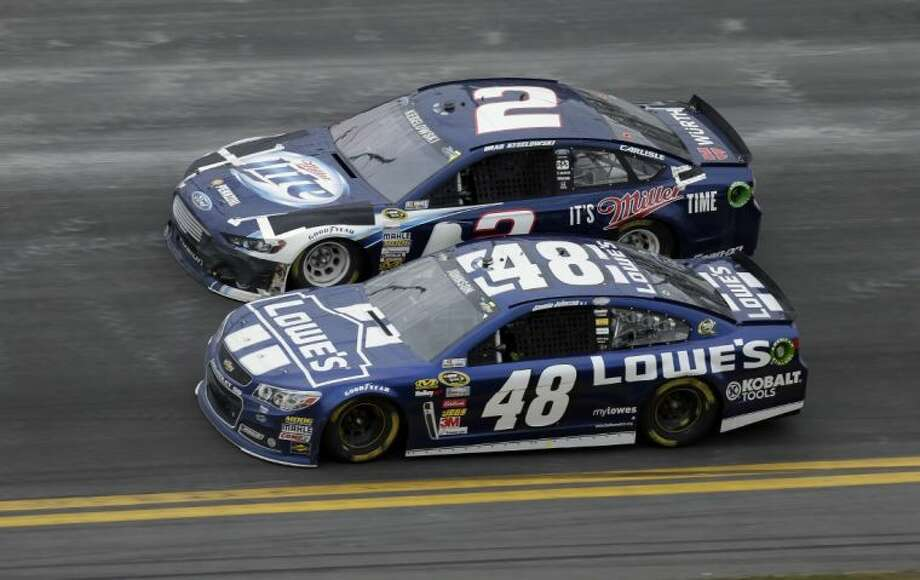 Jimmie Johnson (No. 48 car) battles Brad Keselowski, last year's Sprint Cup champion, for position in the Daytona 500 on Sunday. Johnson won the race. Photo: Chris O'Meara