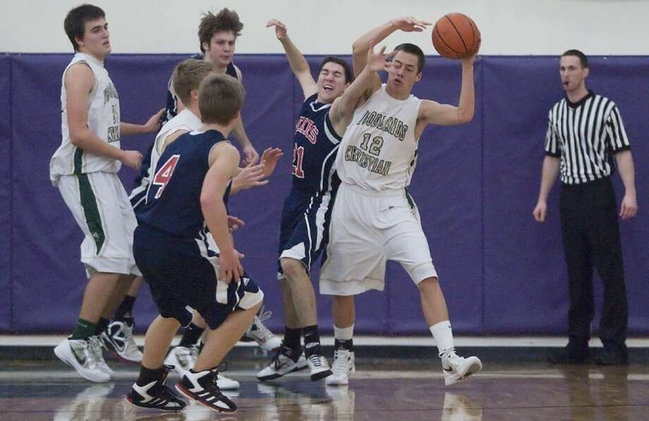 The Woodlands Christian's James Bento pulls in a rebound against Texas Christian on Saturday at The Woodlands Christian Academy.