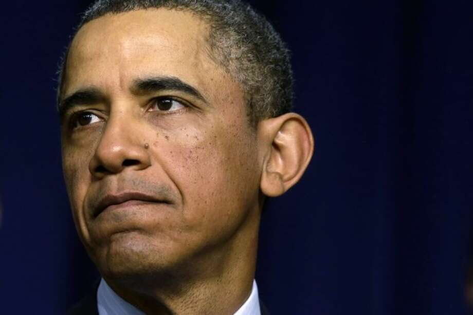 In this Feb. 19 file photo President Barack Obama pauses while talking about sequestration in the Eisenhower Executive Office building on the White House complex in Washington. Lawmakers and the president on the brink of yet another compromise-or-else deadline Friday, March 1, 2013.