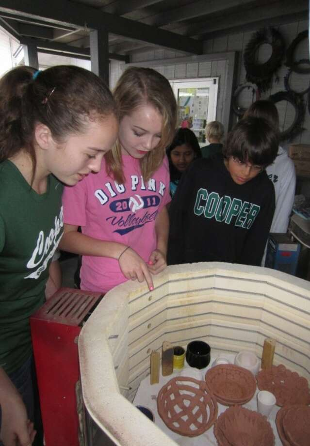 Students at The John Cooper School have been busy in their art classes creating bowls for the annual Empty Bowls Project, which is from 10:30 a.m. to 2 p.m. Feb. 25. Pictured are Cooper students creating bowls for the event that is sponsored by the Cooper chapter of the National Art Honor Society. Photo: Courtesy Photo
