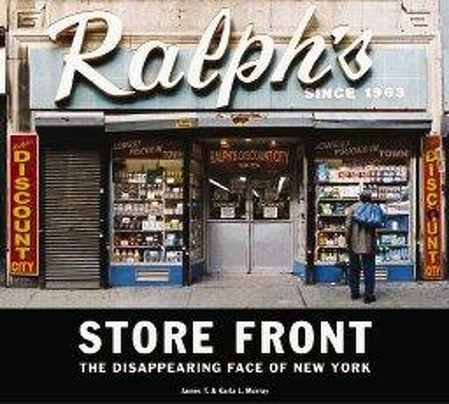 """In this image released by Gingko Press, the cover of, """"Store Front, The Disappearing Face of New York,"""" by James T. and Karla L. Murray. / Gingko Press"""