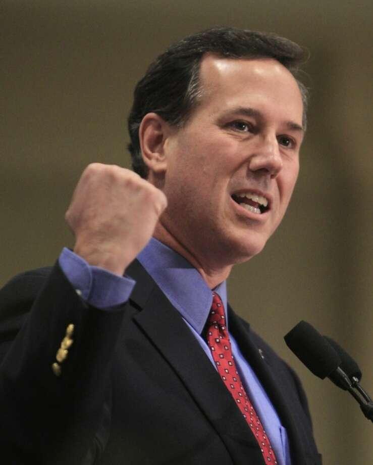 Republican presidential candidate, former Pennsylvania Sen. Rick Santorum speaks at the Summit County Lincoln Dinner Saturday, Feb. 18, 2012, in Akron, Ohio. (AP Photo/Tony Dejak) Photo: Tony Dejak