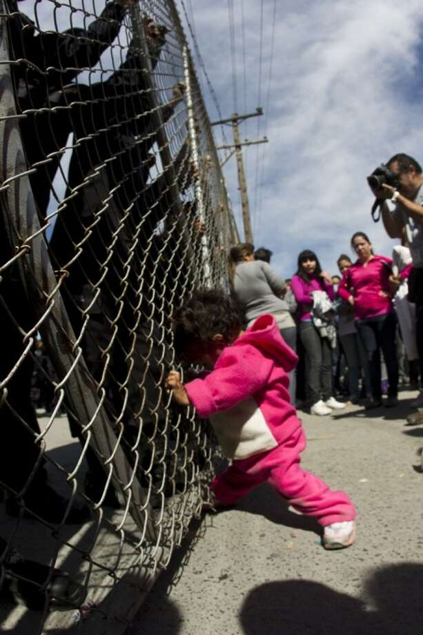 A child yells out for her father as she pushes on a gate at the Apodaca correctional state facility. Photo: Hans-Maximo Musielik