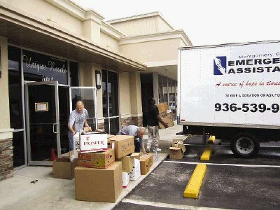 Staff and volunteers with Montgomery County Emergency Assistance unloaded trucks Monday to prepare for the opening of Unique Resale today.