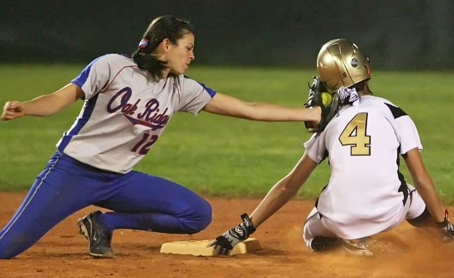 Oak Ridge's Alayna Ammons tags out Conroe's Samantha Belongia during Wednesday night's district game.