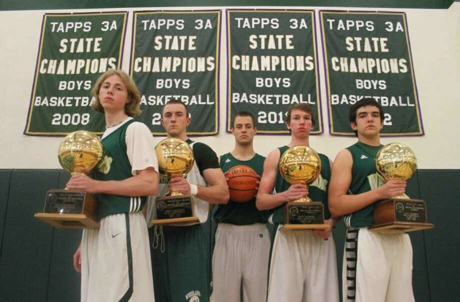 The Woodlands Christian is shooting for its third straight TAPPS Class 3A state championship and fifth in six years. From left, senior starters Bob Sievert, Justin Jeggle, James Bento and Jeremy Swisher and sophomore point guard Kyle Kontor. Photo: Jason Fochtman
