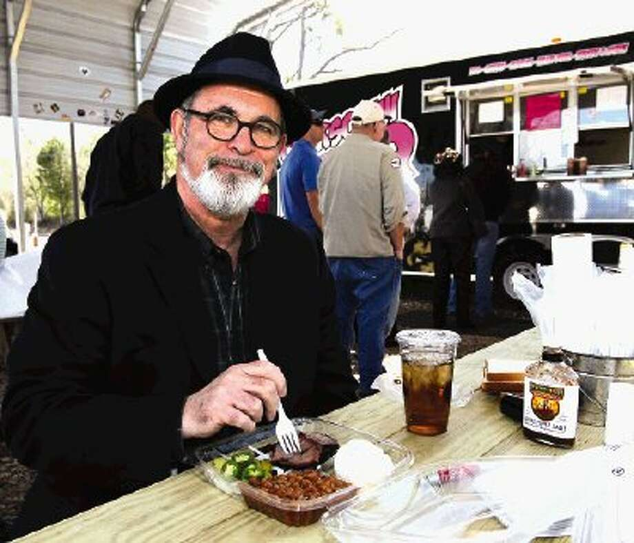 Veteran trial attorney Dale Trimble of Conroe prepares to dig into a plate of brisket at Corkscrew BBQ in Spring.