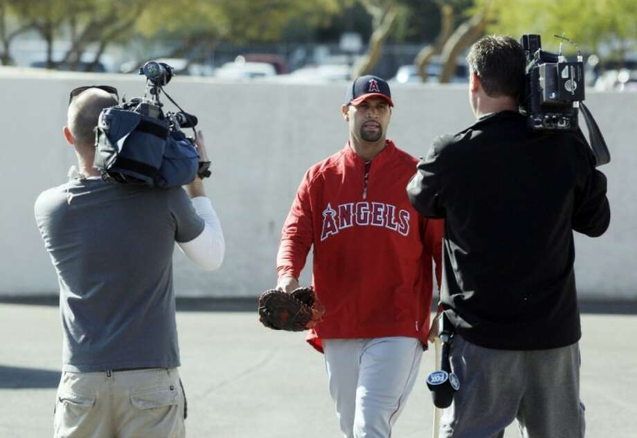 Los Angeles Angels' Albert Pujols makes his way to a batting cage during a spring training baseball workout Monday in Tempe, Ariz. Photo: Morry Gash