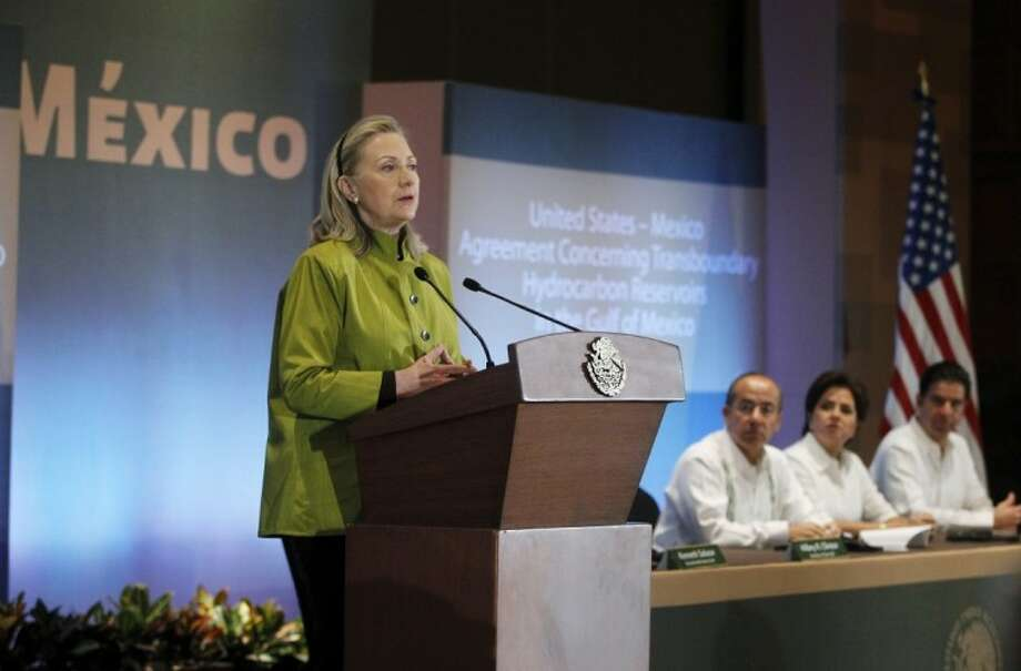 Secretary of State Hillary Rodham Clinton speaks in Los Cabos, Mexico Monday before signing the United States-Mexico Agreement Concerning Transboundary Hydrocarbon Reservoirs in the Gulf of Mexico. From left are, Clinton, Mexico's President Felipe Calderon, Mexico's Foreign Minister Patricia Espinosa, and Mexico's Secretary of Energy Jordy Herrera. Photo: Charles Dharapak