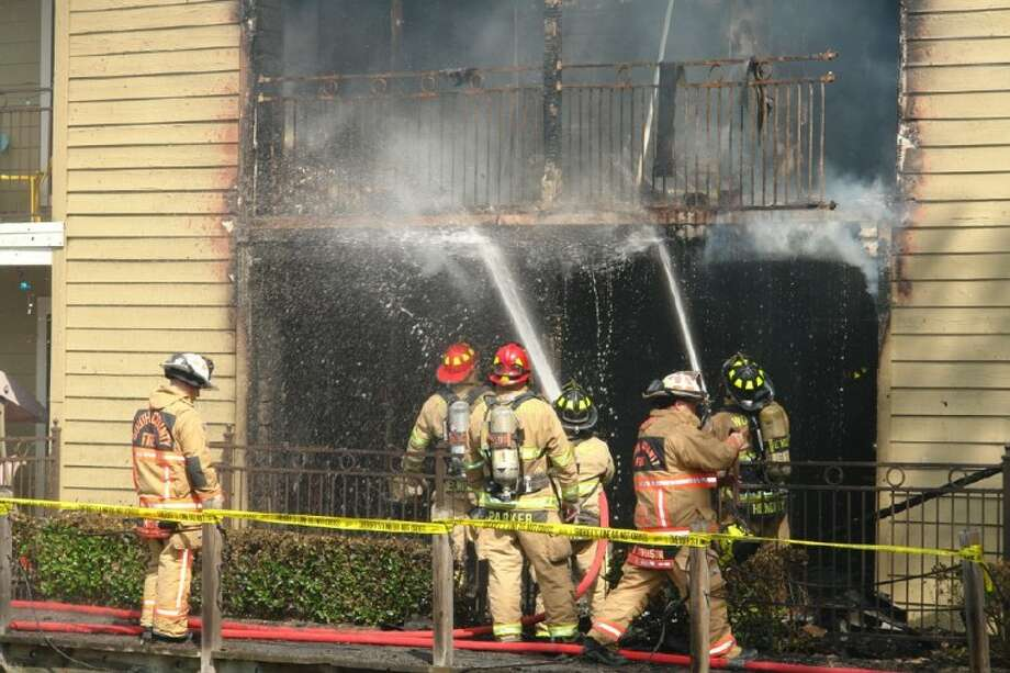 The Woodlands Fire Department, along with crews from Timber Pines and the South Montgomery Fire Department, fought flames at the Village Square Apartments in The Woodlands Sunday afternoon.