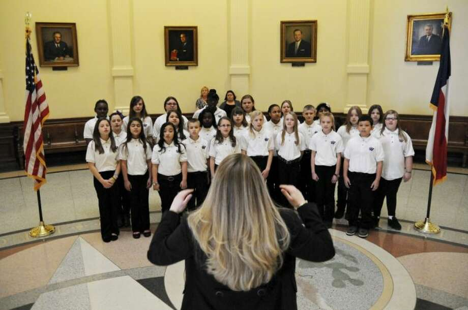 The Willis ISD Parmley Performers school choir performs in the Rotunda of the state Capitol in Austin Thursday. Six students from the district were honored on the House floor for their success in the Student Spaceflight Experiments Program. Photo: Shelby Tauber