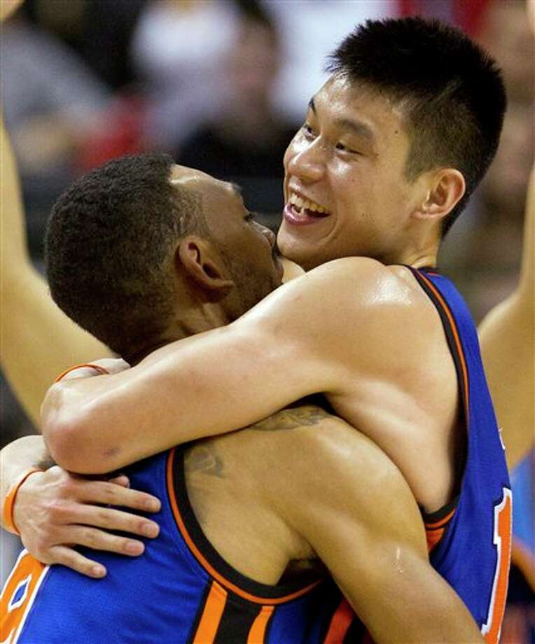 FILE - In this Feb. 14, 2012 file photo, New York Knicks guard Jeremy Lin, right, celebrates with teammate Jared Jeffries after his game-winning 3-pointer in the final seconds of NBA basketball game against the Toronto Raptors in Toronto. First, he lifted the Knicks back into the playoff hunt. Now Lin has put them back on TV. Madison Square Garden has reached a deal to put Knicks games back on television for some 2 million Time Warner Cable subscribers in the New York area, according to New York state officials who had pressured the companies to settle. (AP Photo/The Canadian Press, Frank Gunn, File) Photo: Frank Gunn / AP2012
