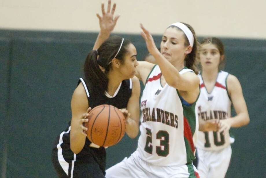 The Woodlands' Anna Strickland (23) will be one of nine seniors helping the Lady Highlanders in tonight's Region II-5A quaterfinals against No. 2 Pflugerville at 7 p.m. tonight at A&M Consolidated High School in College Station. Photo: Karl Anderson