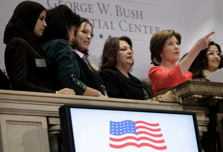 Former First Lady Laura Bush, second from right, rings the opening bell at the New York Stock Exchange before in New York Tuesday. Photo: Seth Wenig