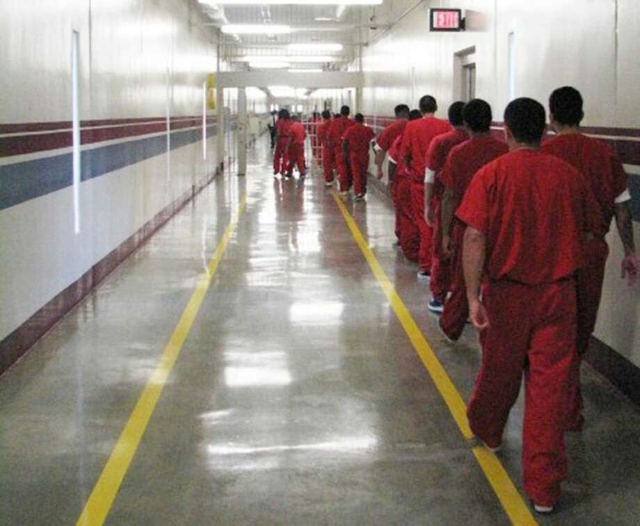 In this undated photo, immigrants walk to hearings at the Stewart Detention Center in Lupmkin, Ga. Photo: Jeremy Redmon