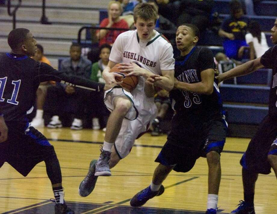 The Woodlands' Brian Baehl pushes past Dekaney defenders during Tuesday night's playoff game in The Woodlands. Photo: Staff Photo By Eric S. Swist