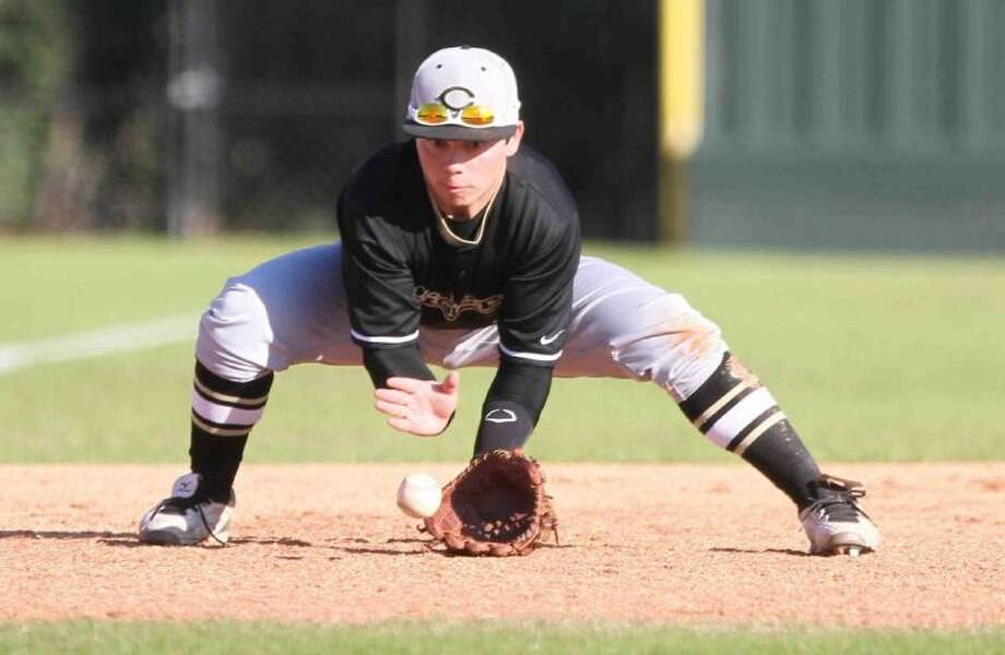 Conroe third baseman Chris Stevenson went 2-for-2 with an RBI in Saturday's 8-7 loss to Cy Woods. Photo: Jason Fochtman
