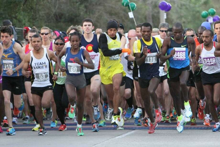 More than 7,000 runners from 12 different countries came to run in The Woodlands Marathon on Saturday. Photo: Jason Fochtman