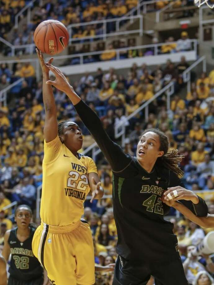 Baylor's Brittney Griner blocks the shot of West Virginia's Linda Stepney. Baylor won 80-49. Photo: DAVID SMITH