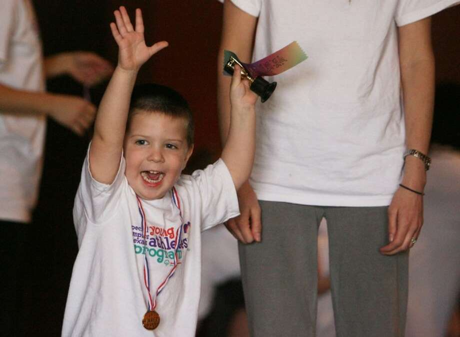 Evan Murphy, 4, raises his arms in celebration after receiving his trophy following Saturday's Future Stars test program put on by The Learning Lane and the Special Olympics.