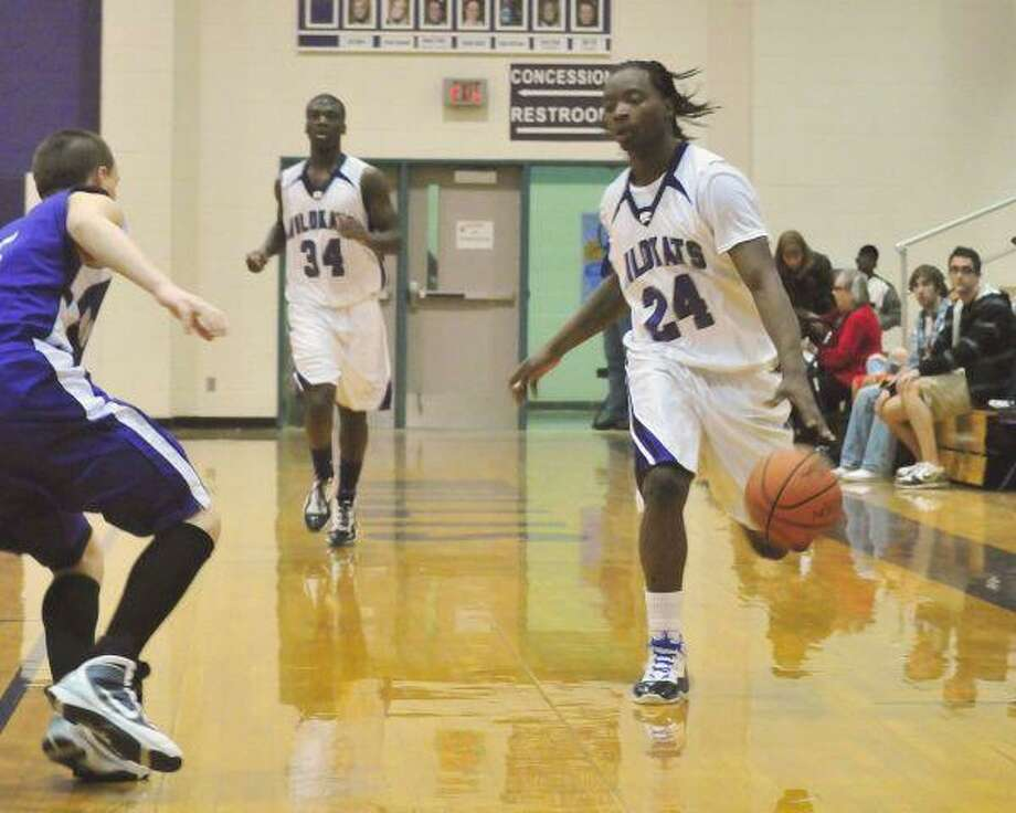 Willis' Brent Walters brings the ball upcourt against Montgomery at Willis High School Friday night.