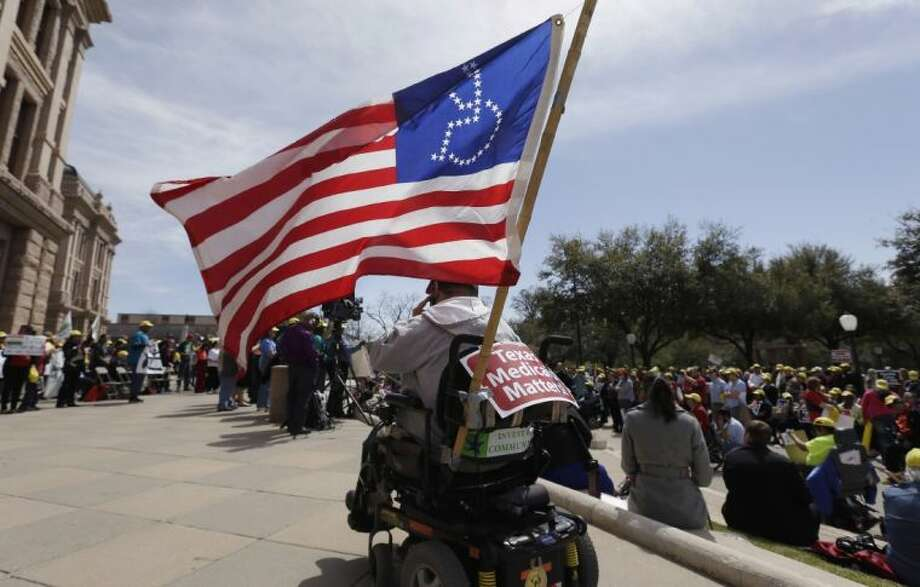 Protesters gather as they march on the Texas capitol Tuesday in Austin. Protesters demanded that lawmakers expand Medicaid to include an additional 1.5 million poor people. Photo: Eric Gay