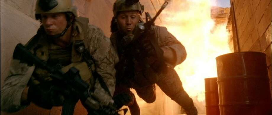 "In this image released by Relativity Media, a scene is shown from the film ""Act of Valor,"" starring real, active-duty Navy SEALs. Photo: Courtesy Of IATM LLC"