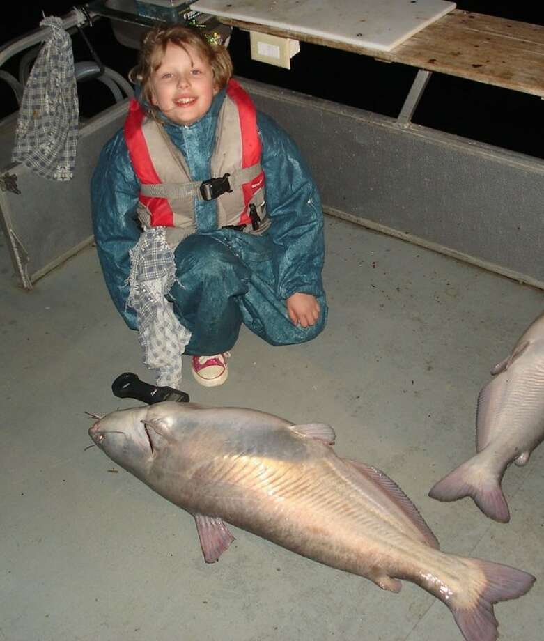 "Julianna ""Jewels"" Mize, an 8-year-old at Turner Elementary School in Willis, is pictured with her record-breaking blue catfish."
