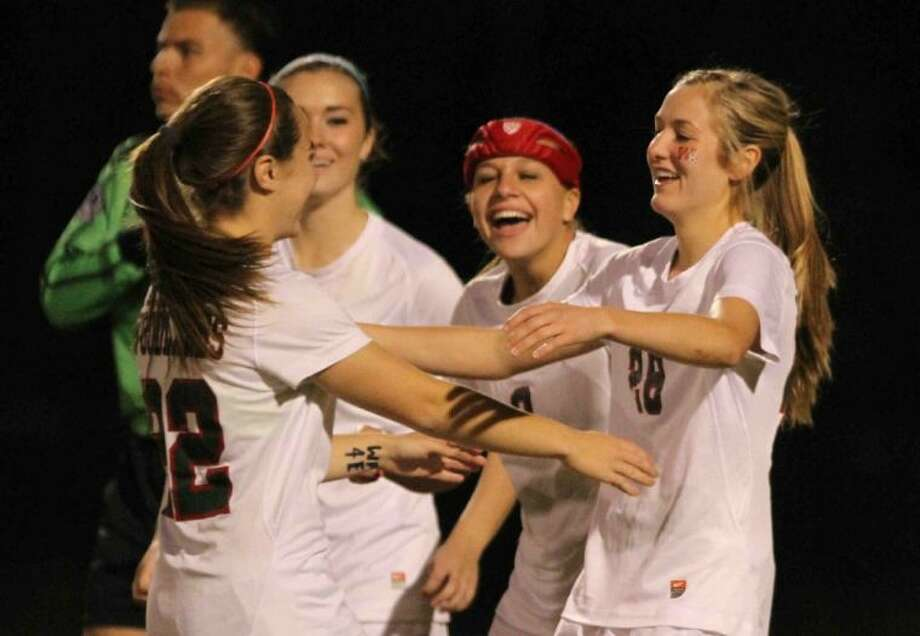 The Woodlands forward Kaleigh Olmsted (28) celebrates with teammates after scoring a goal during Tuesday's match against A&M Consolidated. To view or purchase this photo and others like it, visit HCNpics.com. Photo: Jason Fochtman