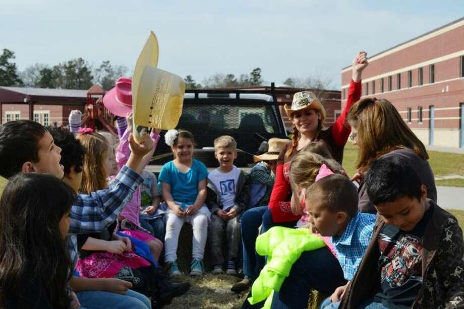Kindergarten teacher Amy Ohnheiser takes a hayride with her students Thursday at Wilkinson Elementary.