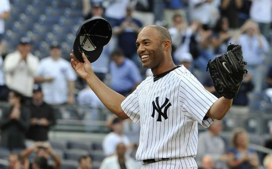 New York Yankees closer Mariano Rivera acknowledges the cheers of the crowd after recording his 602nd career save in a 6-4 win over the Minnesota Twins on Sept. 19, 2011, in New York. Photo: Kathy Kmonicek