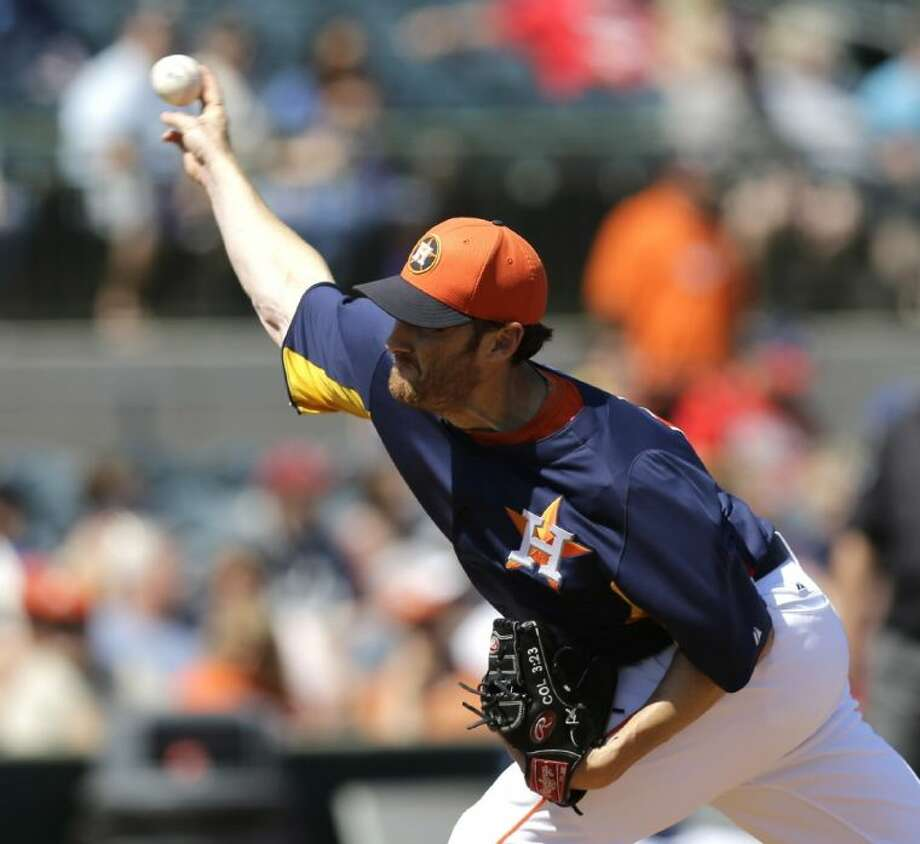 Houston Astros pitcher Philip Humber throws against the Washington Nationals during the first inning Thursday in Kissimmee, Fla. Photo: David J. Phillip