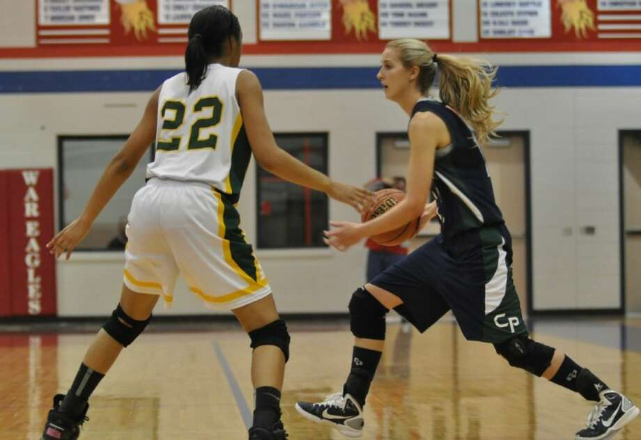 College Park's Megan Shafer, right, looks for an opening in the defense during Monday's Region II-5A Bi-district game with Klein Forest at Oak Ridge High School.
