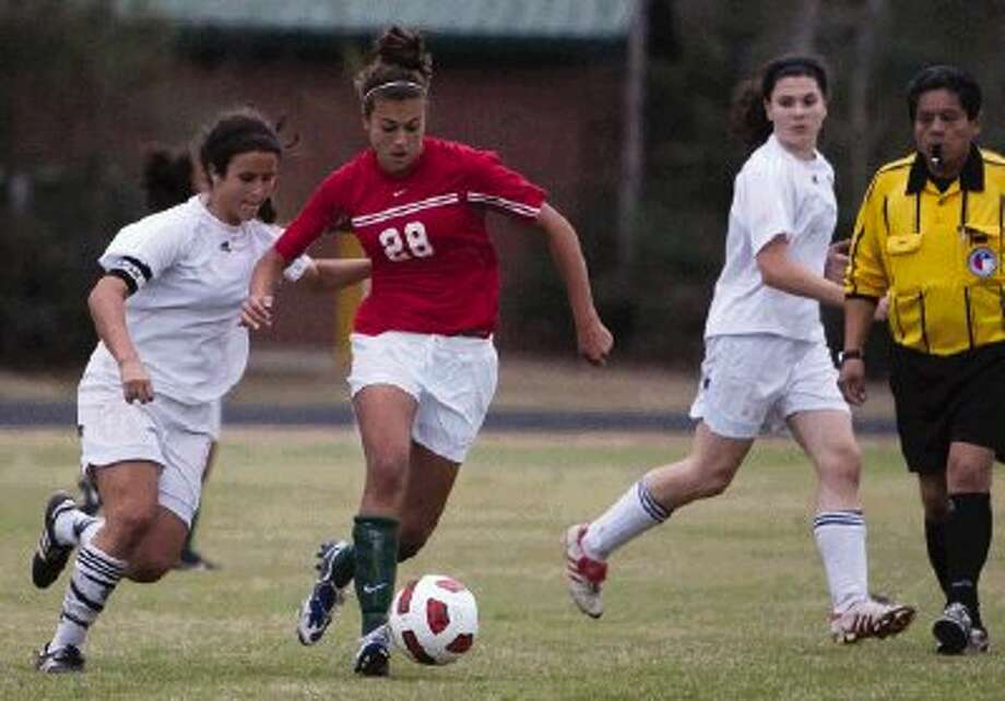 The Woodlands' Marissa Lipar dribbles downfield against St. Agnes during the Lady Highlander Invitational earlier this season. / The Courier