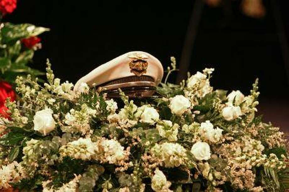 Conroe Police Sgt. Gary Hardage's cap rests atop a wreath of white roses during his funeral at The Ark Family Church Thursday. / Staff