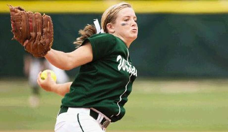The Woodlands' Paige McDuffee delivers a pitch against New Caney during the playoffs last season. McDuffee returns for the No. 7 state-ranked Lady Highlanders who, along with other area teams, kick off the season this week. / The Courier