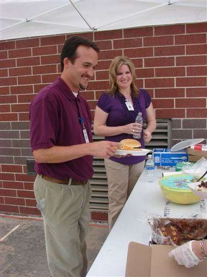 Jeff Robert, Willis High School health science technology teacher and head women's soccer coach, gets ready to enjoy his lunch, provided by the WHS Band Boosters May 7 in honor of Teacher Appreciation Week. Looking on is Patti Shannon, 2009-10 President of the WHS Band Boosters.
