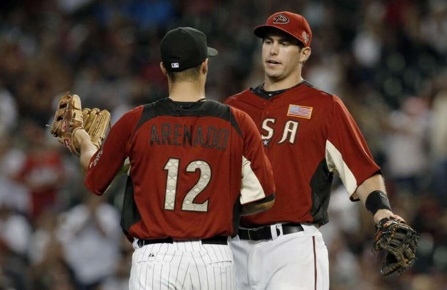 The Wodolands grad and current Arizona Diamondback Paul Goldschmidt, right, celebrates with Nolan Arenado at last season's MLB All-Star Futures baseball game in Phoenix. Photo: Ross D. Franklin
