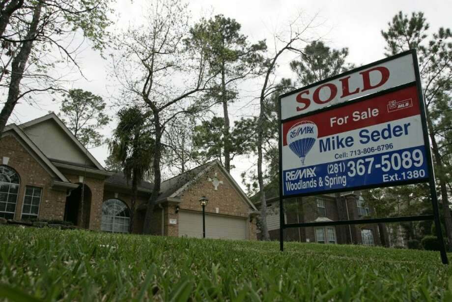 A sold sign sits in the front yard of a home, which shows proof the housing market is recovering. Photo: Submitted Photo